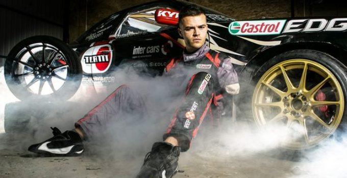 PBartek-Ostalowski-poses-for-a-photo-next-to-his-racing-car